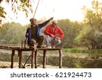 two fishermen with fishing rods ... | Shutterstock . vector #621924473