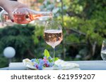 waiter pouring a glass of cold... | Shutterstock . vector #621959207