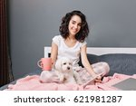 joyful young woman with curly... | Shutterstock . vector #621981287