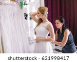 female trying on wedding dress