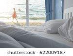 white pillows and bedding sheet ... | Shutterstock . vector #622009187
