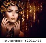 gold woman holiday makeup.... | Shutterstock . vector #622011413