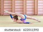 young girl doing gymnastics. | Shutterstock . vector #622011593