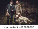 two hunters with dogs and...   Shutterstock . vector #622020233