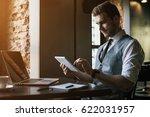 young handsome man working in... | Shutterstock . vector #622031957