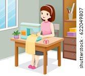 woman sewing clothes by sewing... | Shutterstock .eps vector #622049807