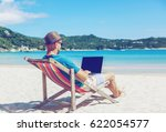 young hipster man with laptop... | Shutterstock . vector #622054577