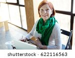 busy mature woman making notes... | Shutterstock . vector #622116563