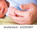 Close Up Mother Finger Holding...