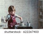 little boy in a pottery | Shutterstock . vector #622267403