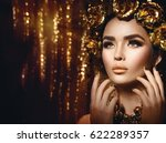 gold woman holiday makeup.... | Shutterstock . vector #622289357