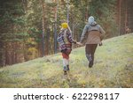 a couple runs through the woods | Shutterstock . vector #622298117