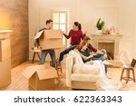 man holding box while friends... | Shutterstock . vector #622363343