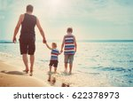 father and sons walking at the... | Shutterstock . vector #622378973