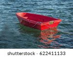 Small Red Dinghy Tied Up In Th...
