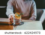 man drinking alcoholic cocktail ... | Shutterstock . vector #622424573