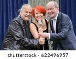 Three Lively Performers Having...