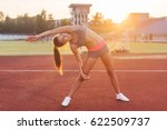 fit woman doing side bend... | Shutterstock . vector #622509737