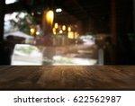 empty dark wooden table in... | Shutterstock . vector #622562987
