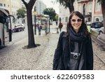 young cheerful woman walking...   Shutterstock . vector #622609583