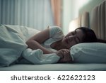 asian woman sleeping in a bed... | Shutterstock . vector #622622123