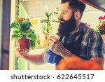 tattooed bearded male watering... | Shutterstock . vector #622645517