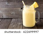 pineapple smoothie in a mason... | Shutterstock . vector #622699997