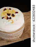 Small photo of Easter composition of sweet bread, paska on black background. Orthodox kulich. Holidays breakfast concept