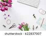 spring flowers on workdesk at... | Shutterstock . vector #622837007