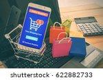 white smartphone runs an online ... | Shutterstock . vector #622882733