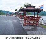Small photo of Lonely wooden pavilions sidle of Khun Dan Prakan Chon Dam, Nakhon Nayok, Thailand