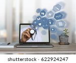 doctor holding stethoscope with ...