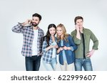 four young friends in casual... | Shutterstock . vector #622999607