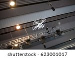 white drone in motion.... | Shutterstock . vector #623001017