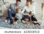 happy family playing with a pet ... | Shutterstock . vector #623018513