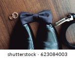 black bow tie lies before... | Shutterstock . vector #623084003
