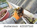roof gutter cleaning tips.... | Shutterstock . vector #623107163