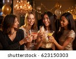 female friends make toast as... | Shutterstock . vector #623150303
