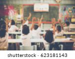 blurred student hands up asking ... | Shutterstock . vector #623181143