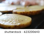 chicken and potatoes on grill  | Shutterstock . vector #623200643