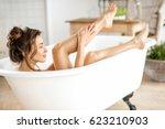 beautiful young woman taking... | Shutterstock . vector #623210903