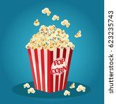 popcorn in a red striped bucket ... | Shutterstock .eps vector #623235743