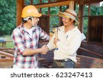 architect engineer shaking... | Shutterstock . vector #623247413