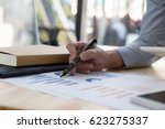 businessman analyzing charts... | Shutterstock . vector #623275337