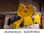 raw thai pumpkin cut half on... | Shutterstock . vector #623291963