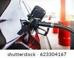 black luxury car refueling in... | Shutterstock . vector #623304167