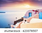 beautiful sunset on santorini... | Shutterstock . vector #623378507