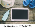 summer time items   tablet  hat ... | Shutterstock . vector #623434283
