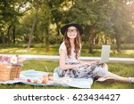 smiling pretty young woman in... | Shutterstock . vector #623434427
