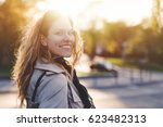 young trendy woman looking back ... | Shutterstock . vector #623482313